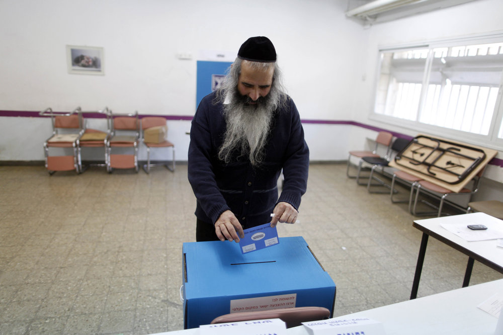 Description of . An Ultra Orthodox Jewish man casts his ballot at a polling station on election day on January 22, 2013 in Jerusalem, Israel. Israel's general election voting has begun today as polls show Netanyahu is expected to return to office with a narrow majority. (Photo by Lior Mizrahi/Getty Images)