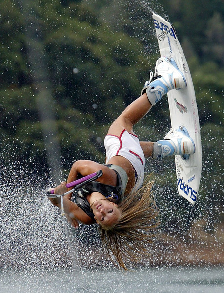 Raequel Hoffman, 17, practices wakeboarding out on Lake Oroville Wednesday morning. - halley photo 7/19/06