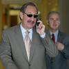 Mark Geragos, left, and Patrick Harris, right, defense attornies for Scott Peterson, break for lunch as they leave the San Mateo County Courthouse in Redwood City, Calif., for the ongoing trial of Scott Peterson on Tuesday, October. 5, 2004. Peterson is the Modesto, Calif., man who is charged with the murders of his wife Laci and their unborn son and could face the death penalty if convicted. (AP Photo/John Green, Pool)