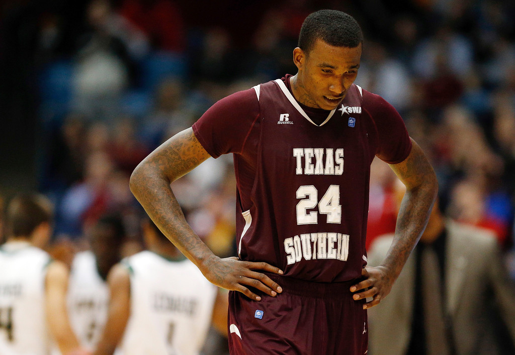 . DAYTON, OH - MARCH 19: Aaric Murray #24 of the Texas Southern Tigers walks off the court after losing to the Cal Poly Mustangs 81-69 in the first round of the 2014 NCAA Men\'s Basketball Tournament at UD Arena on March 19, 2014 in Dayton, Ohio.  (Photo by Gregory Shamus/Getty Images)
