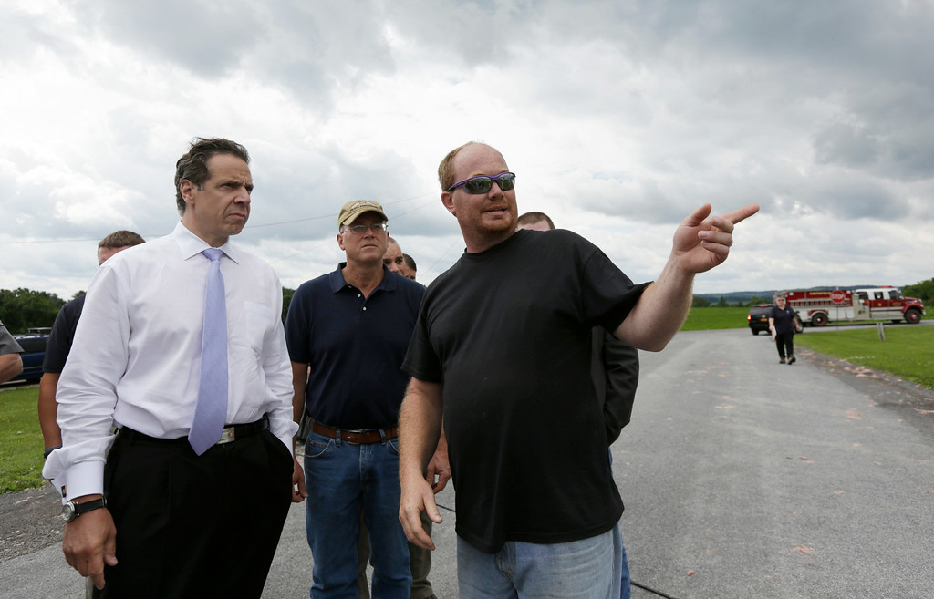 . Allen Wiley, right, describes damage to his home following Tuesday\'s storm, to New York Gov. Andrew Cuomo on Wednesday, July 9, 2014, in Smithfield, N.Y. (AP Photo/Mike Groll)