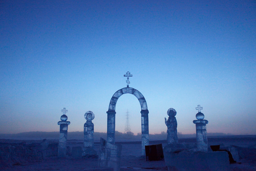 . A view shows ice sculptures on the Lena river, constructed for the celebration of Orthodox Epiphany outside Yakutsk in the Republic of Sakha, northeast Russia, January 17, 2013. The coldest temperatures in the northern hemisphere have been recorded in Sakha, the location of the Oymyakon valley, where according to the United Kingdom Met Office a temperature of -67.8 degrees Celsius (-90 degrees Fahrenheit) was registered in 1933 - the coldest on record in the northern hemisphere since the beginning of the 20th century. Yet despite the harsh climate, people live in the valley, and the area is equipped with schools, a post office, a bank, and even an airport runway (albeit open only in the summer).    Picture taken January 17, 2013.    REUTERS/Maxim Shemetov