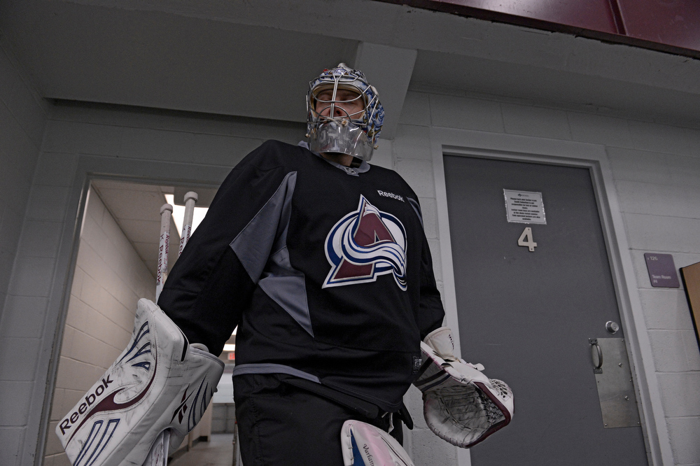 . Colorado Avalanche G Semyon Varlamov (1) heads to the ice for practice Wednesday, January 16, 2013 at Family Sports Center. John Leyba, The Denver Post