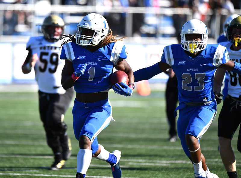 10/19/2019 Mike Orazzi | Staff Central Connecticut State University 's DJ Exilhomme (1) with a TD during Saturday's football game with Bryant in New Britain.