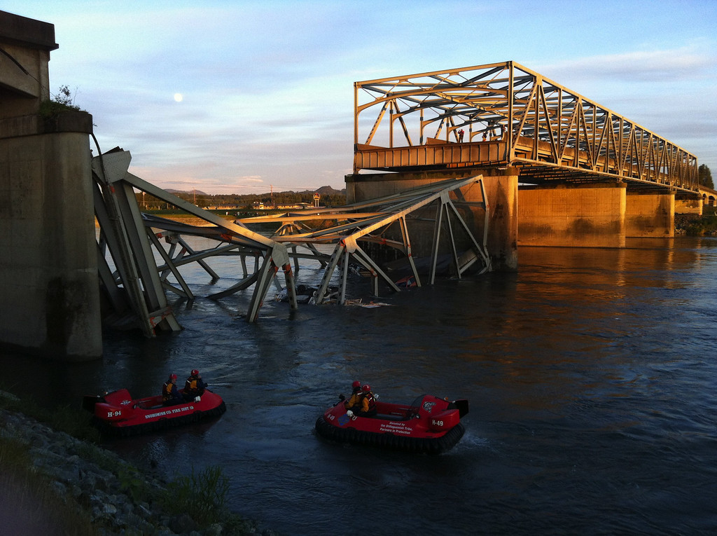 . A portion of the Interstate 5 bridge is submerged after it collapsed into the Skagit River dumping vehicles and people into the water in Mount Vernon, Wash., Thursday, May 23, 2013.  (AP Photo/The Seattle Times, Rick Lund)