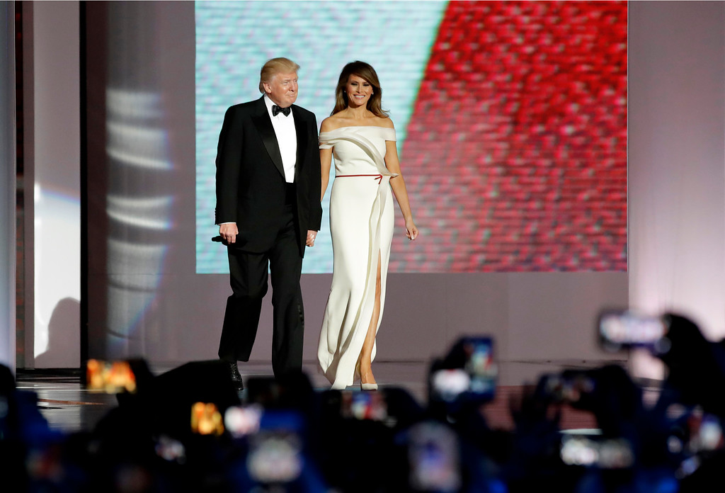 . President Donald Trump, left, arrives with first lady Melania Trump at the Liberty Ball, Friday, Jan. 20, 2017, in Washington. (AP Photo/Patrick Semansky)