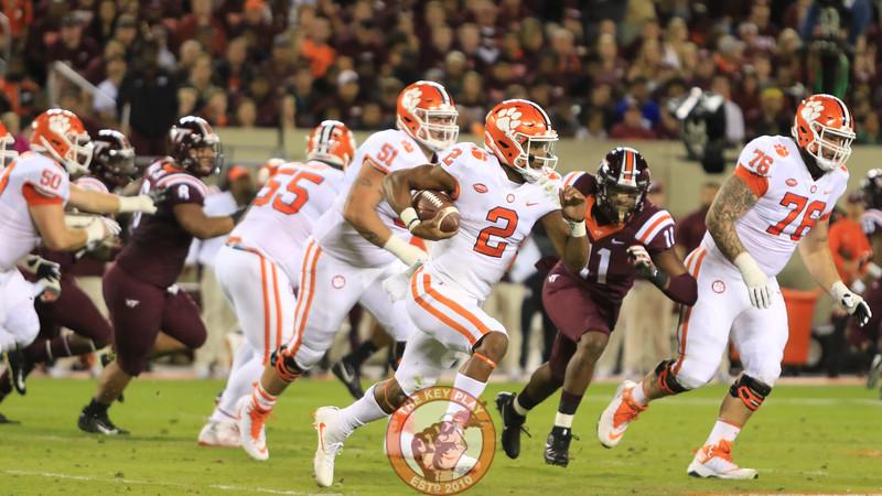 Clemson QB Kelley Bryant runs with the football as Houshun Gaines gives chase. (Mark Umansky/TheKeyPlay.com)