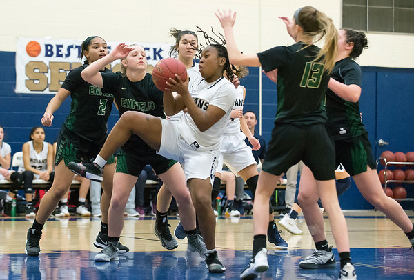 02/20/20 Wesley Bunnell | StaffrrNewington girls basketball defeated Enfield on thursday night at home in the first round of the conference tournament. Ashanti Frazier (10) with a rebound.
