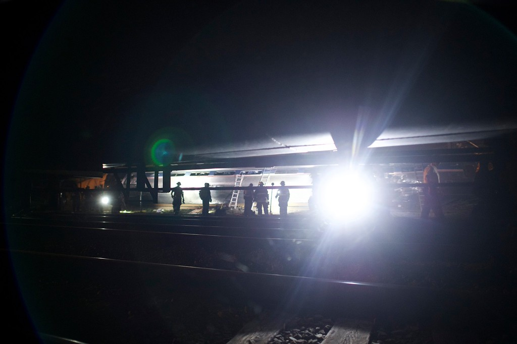 . PHILADELPHIA, PA - MAY 12:  Emergency workers search for the injured after an Amtrak passenger train carrying more than 200 passengers from Washington, DC to New York derailed May 12, 2015 in north Philadelphia, Pennsylvania. At least five people were killed and more than 50 others were injured in the crash.  (Photo by Mark Makela/Getty Images)