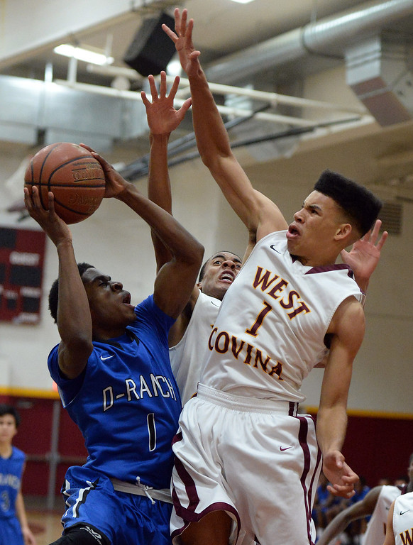 . Diamond Ranch\'s Ernest Ugoagu (1) drives to the basket as West Covina\'s Michael Fallon (1) defends in the first half of a prep basketball game at West Covina High School in West Covina, Calif., on Wednesday, Jan. 8, 2014. (Keith Birmingham Pasadena Star-News)