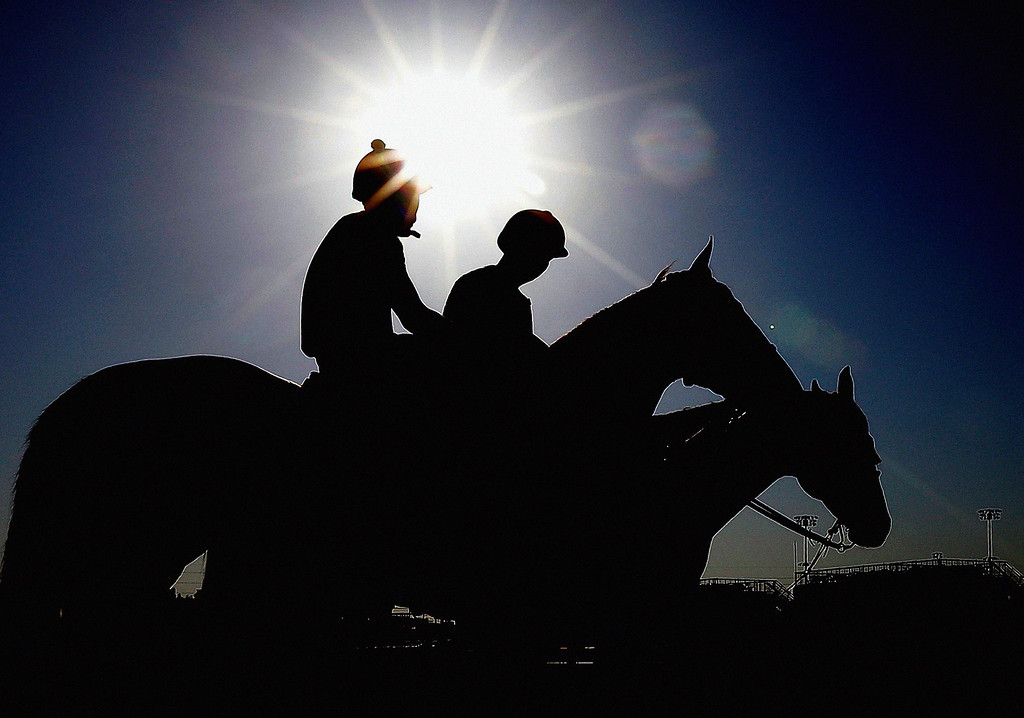. Exercise rider Emerson Chavez waits to take Kentucky Derby hopeful Golden Soul for a workout at Churchill Downs Wednesday, May 1, 2013, in Louisville, Ky. (AP Photo/Morry Gash)