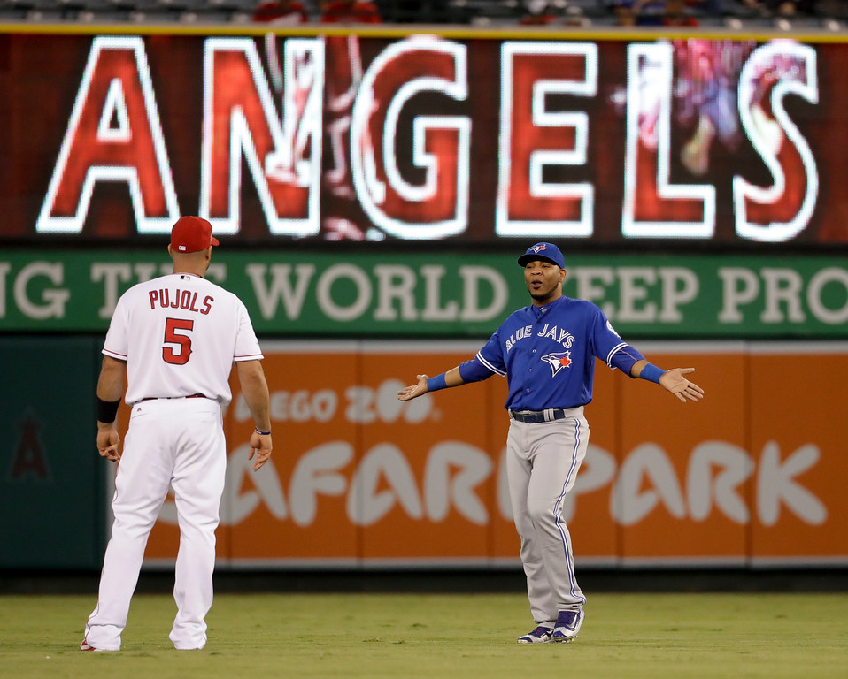 . Toronto Blue Jays first baseman Edwin Encarnacion, right, talks with Los Angeles Angels designated hitter Albert Pujols before a baseball game in Anaheim, Calif., Thursday, Sept. 15, 2016. (AP Photo/Chris Carlson)