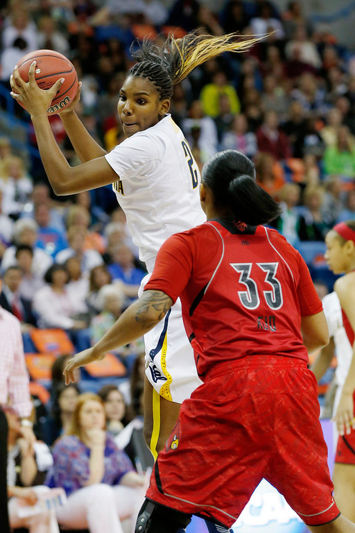. California forward Reshanda Gray (21) grabs a rebound against Louisville forward Monique Reid (33) in the first half of a national semifinal at the Women\'s Final Four of the NCAA college basketball tournament, Sunday, April 7, 2013, in New Orleans. (AP Photo/Dave Martin)