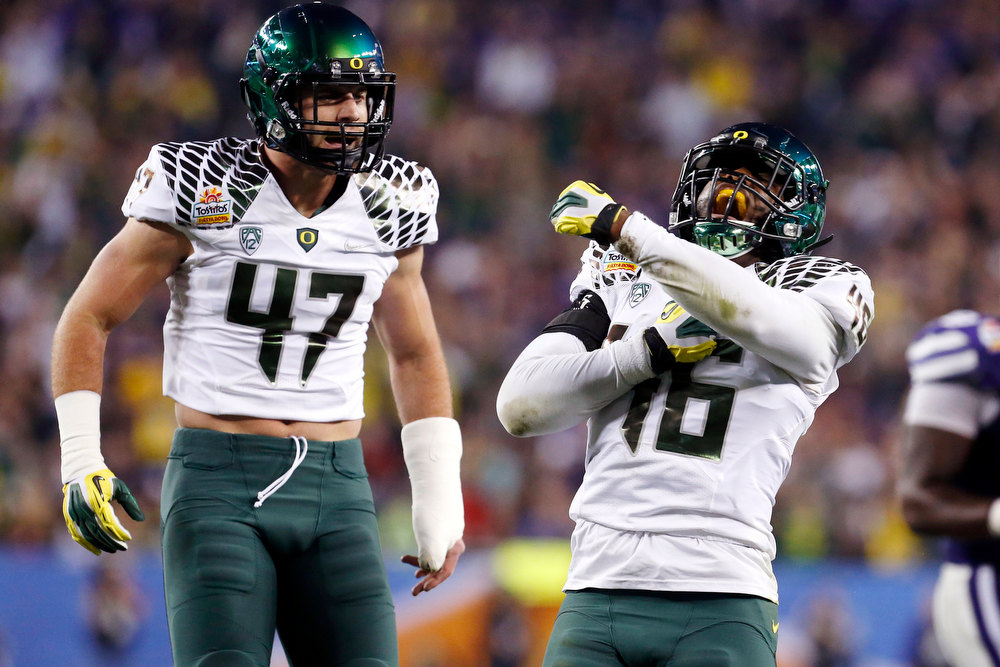 Description of . Oregon linebacker Michael Clay (46) and Kiko Alonso (47) celebrate a stop against Kansas State during the first half of the Fiesta Bowl NCAA college football game, Thursday, Jan. 3, 2013, in Glendale, Ariz. (AP Photo/Ross D. Franklin)