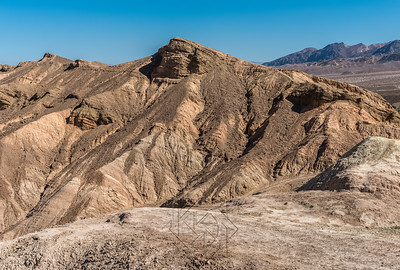 Low view of ridge of with Zabriskie Point in the background