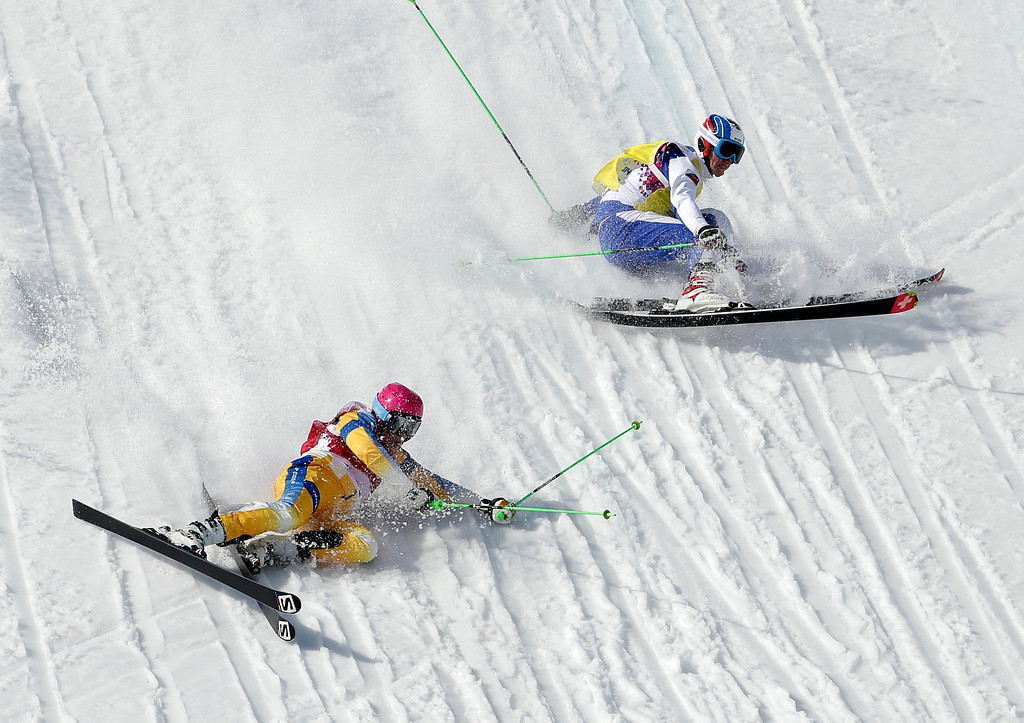 . Sweden\'s Victor Oehling Norberg, left, and Russia\'s Igor Korotkov crash during a men\'s ski cross heat at the Rosa Khutor Extreme Park, at the 2014 Winter Olympics, Thursday, Feb. 20, 2014, in Krasnaya Polyana, Russia. (AP Photo/Andy Wong)