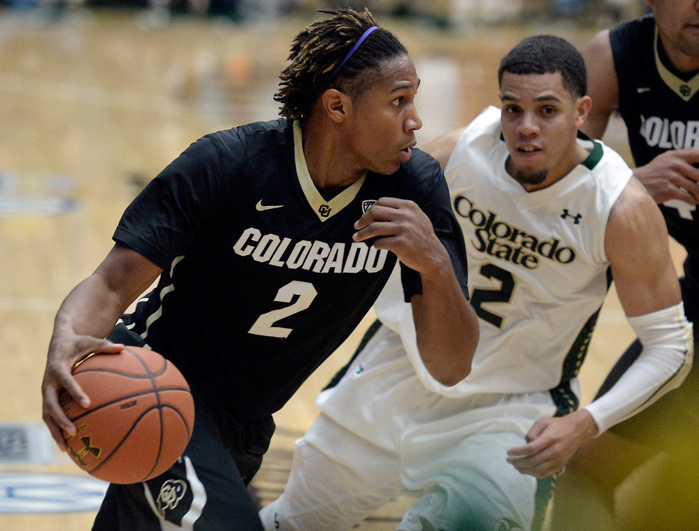 . Colorado\'s Xavier Johnson drives to the hoop past Daniel Bejarano during an NCAA game against CSU on Tuesday, Dec. 3, 2013, at the Moby Arena in Fort Collins. CU won the game 67-62. Jeremy Papasso/ Camera