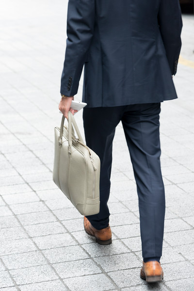 Businessman walking on roadside, Seoul, South Korea