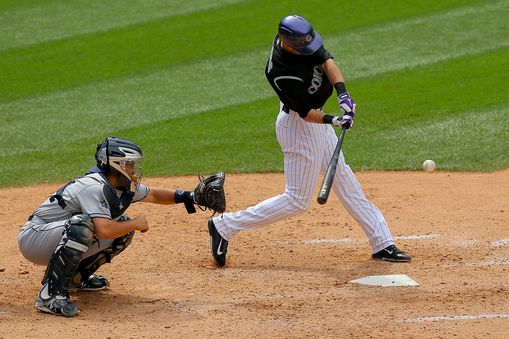 . DENVER, CO - JULY 9:  Drew Stubbs #13 of the Colorado Rockies hits a two run home run to put the Rockies ahead of the San Diego Padres in the eighth inning at Coors Field on July 9, 2014 in Denver, Colorado. (Photo by Justin Edmonds/Getty Images)