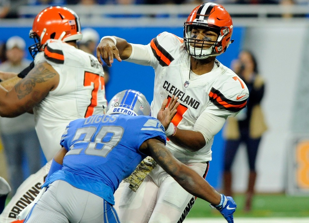 . Detroit Lions cornerback Quandre Diggs (28) closes in on Cleveland Browns quarterback DeShone Kizer (7) during the second half of an NFL football game, Sunday, Nov. 12, 2017, in Detroit. Kizer left the game after the hit. (AP Photo/Jose Juarez)