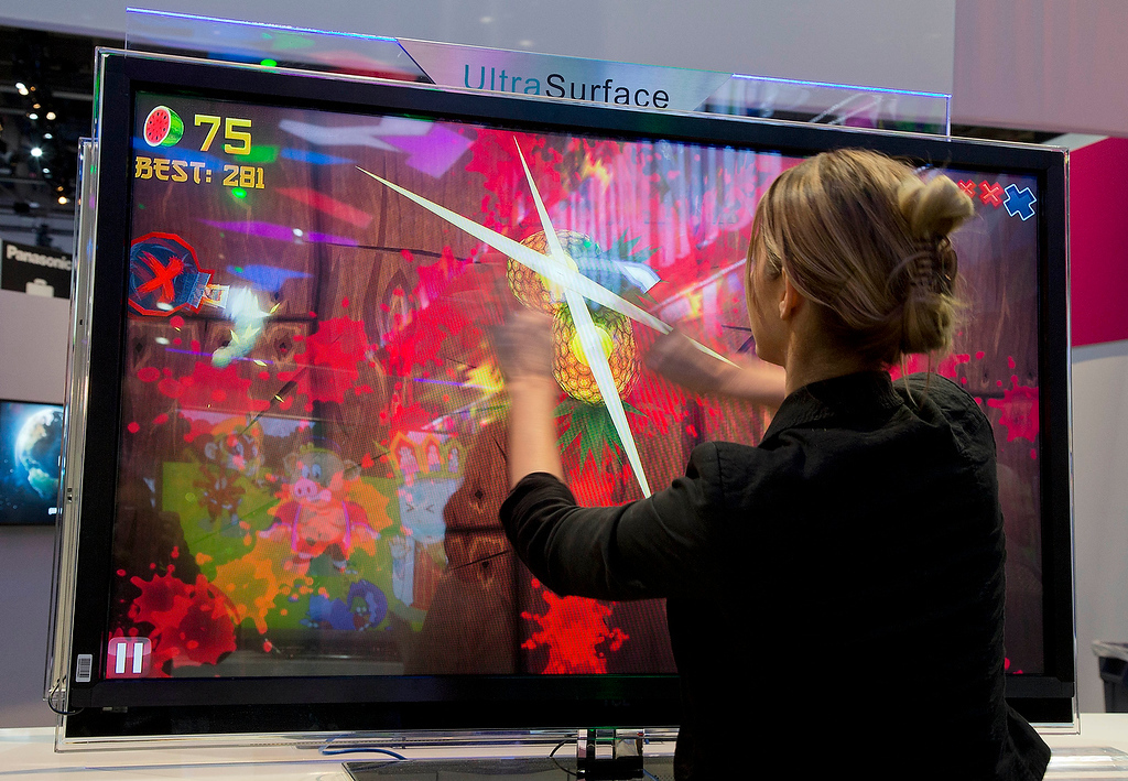 . An attendee plays Fruit Ninja at the Panasonic booth at the Consumer Electronics Show, Thursday, Jan. 10, 2013, in Las Vegas. (AP Photo/Julie Jacobson)