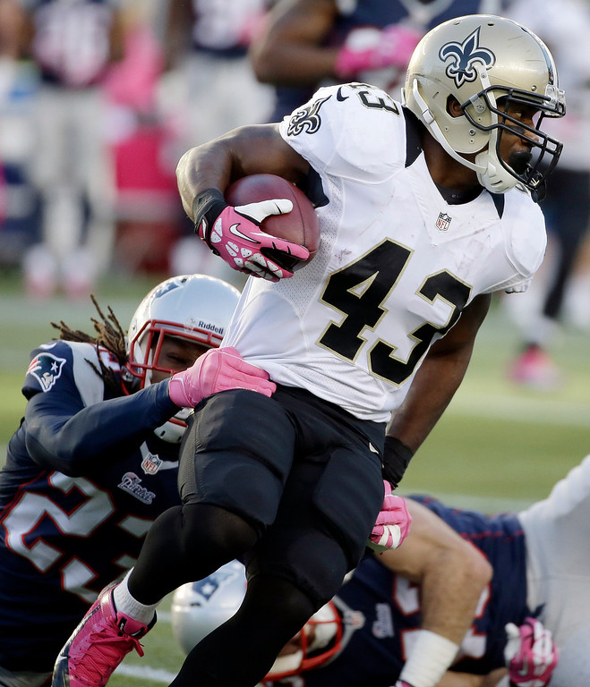 . New England Patriots defensive back Marquice Cole (23) tackles New Orleans Saints running back Darren Sproles (43) in the first quarter of an NFL football game Sunday, Oct.13, 2013, in Foxborough, Mass. (AP Photo/Stephan Savoia)