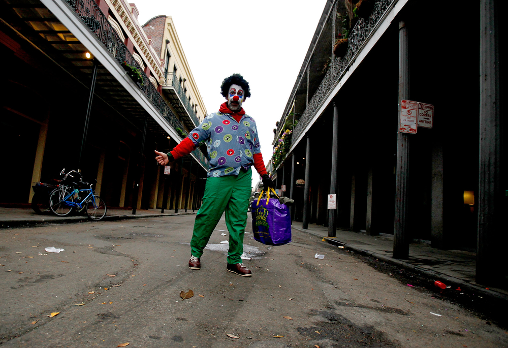Description of . A reveler walks through the French Quarter as New Orleans Holds Citywide Mardi Gras Celebration on March 4, 2014 in New Orleans, Louisiana. Fat Tuesday, the traditional celebration on the day before Ash Wednesday and the beginning of Lent, is marked in New Orleans with parades and marches through many neighborhoods in the city. (Photo by Sean Gardner/Getty Images)
