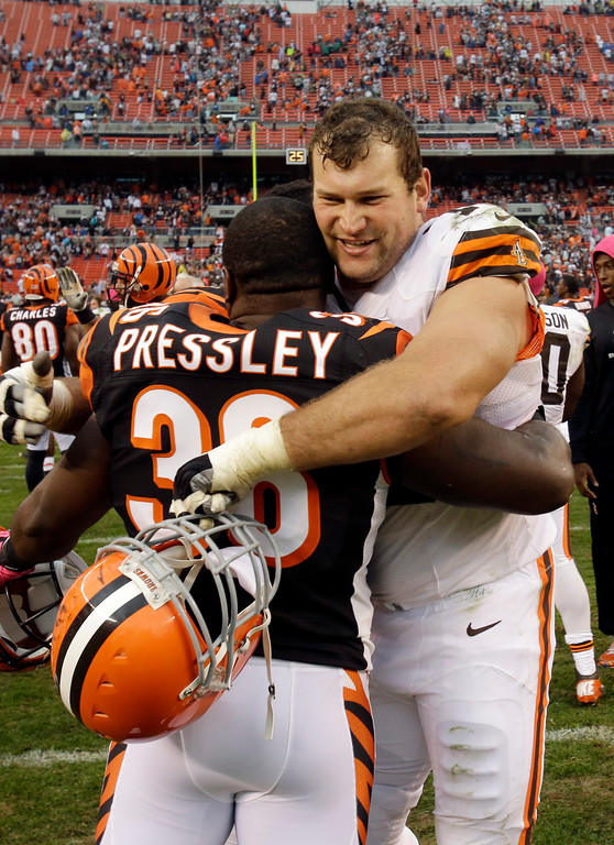 . Cleveland Browns offensive tackle Joe Thomas hugs Cincinnati Bengals cornerback Shaun Prater (38) after the Browns\' 34-24 win in an NFL football game Sunday, Oct. 14, 2012, in Cleveland. (AP Photo/Mark Duncan)