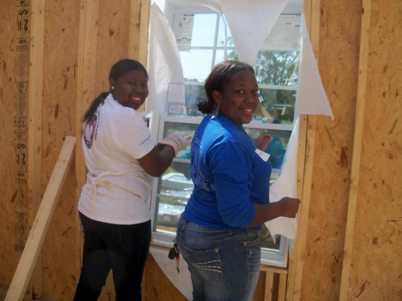 Reshyra Walker, left and Tiffany Core work together.