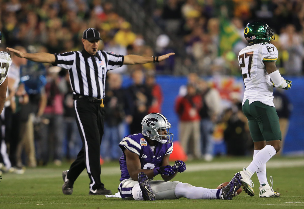 Description of . Chris Harper #3 of the Kansas State Wildcats reacts after an incomplete pass on the third down during the Tostitos Fiesta Bowl against the Oregon Ducks at University of Phoenix Stadium on January 3, 2013 in Glendale, Arizona.  (Photo by Doug Pensinger/Getty Images)