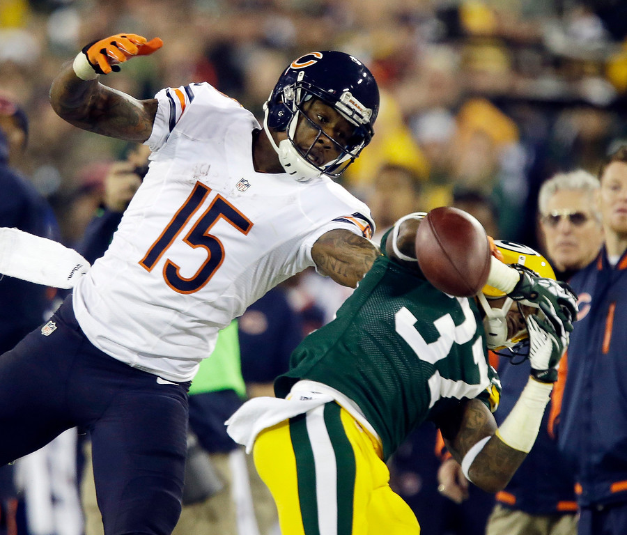 . Green Bay Packers\' Sam Shields breaks up a pass intended for Chicago Bears\' Brandon Marshall (15) during the second half of an NFL football game Monday, Nov. 4, 2013, in Green Bay, Wis. (AP Photo/Jeffrey Phelps)