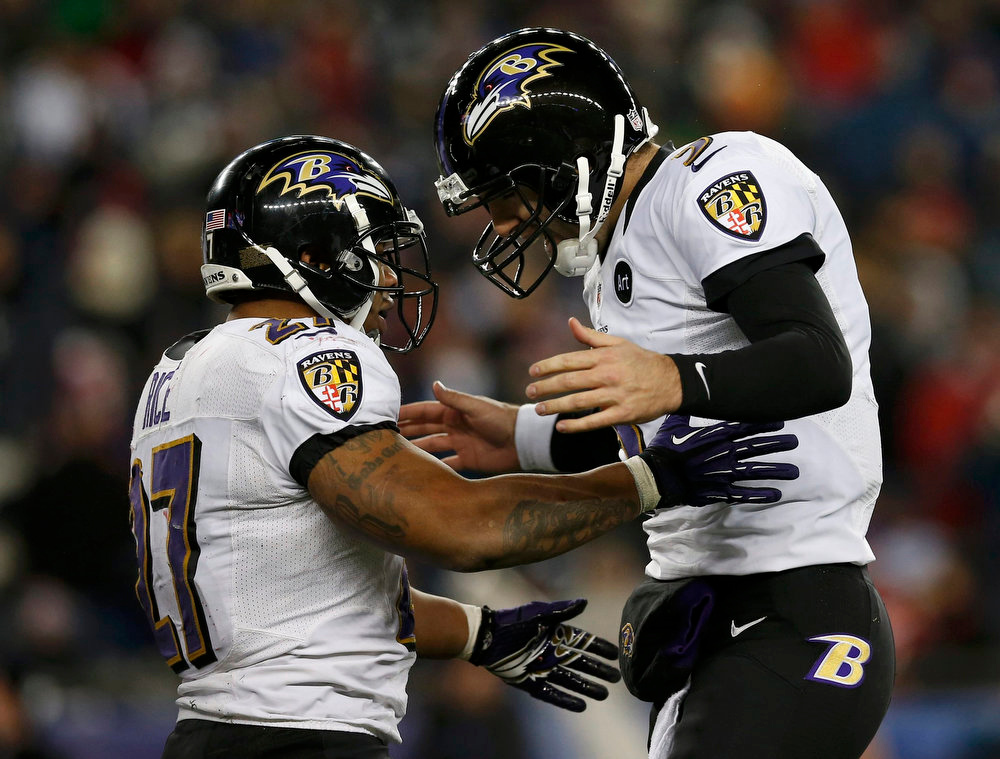 Description of . Baltimore Ravens quarterback Joe Flacco (5) celebrates his fourth quarter touchdown pass against the New England Patriots with running back Ray Rice (L) during the NFL AFC Championship football game in Foxborough, Massachusetts, January 20, 2013. REUTERS/Jim Young