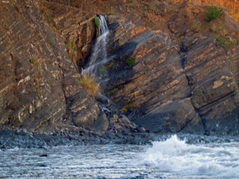 Waterfall and waves at Whale Watch Inn