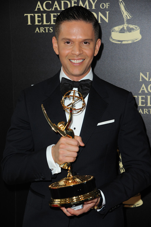 . Rodner Figueroa poses in the press room with the award for outstanding daytime talent in Spanish for ìEl Gordo y la Flacaî at the 41st annual Daytime Emmy Awards at the Beverly Hilton Hotel on Sunday, June 22, 2014, in Beverly Hills, Calif. (Photo by Richard Shotwell/Invision/AP)