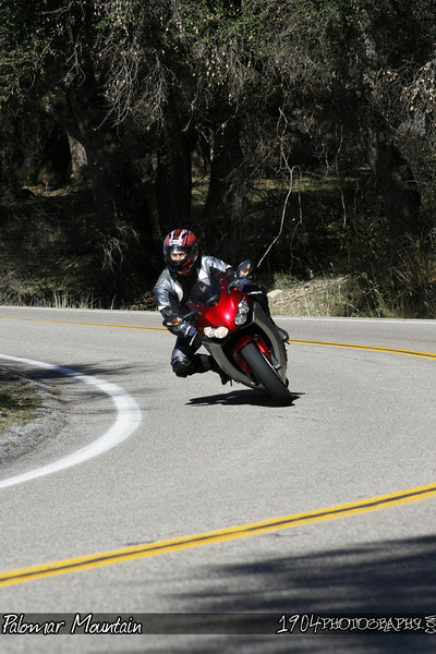 A yamaha R1 motorcycle rider heads down south grade road on palomar mountain.