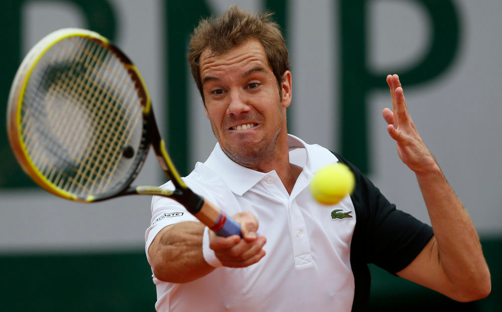 . France\'s Richard Gasquet hits a forehand shot to Ukraine\'s Sergiy Stakhovsky during a French tennis Open first round match on May 27, 2013 at the Roland Garros stadium in Paris.  PATRICK KOVARIK/AFP/Getty Images