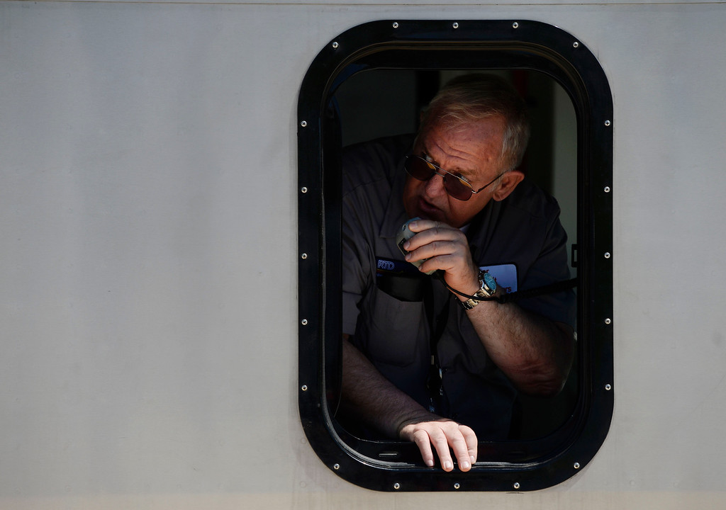 . RTD train operator Michael Stewart gets on the radio moments before departing from Denver International Airport on the new RTD University of Colorado A-Line train April 22, 2016. The train service stretches from Union Station to Denver International Airport April 21, 2016 with five stations in between (Photo by Andy Cross/The Denver Post)