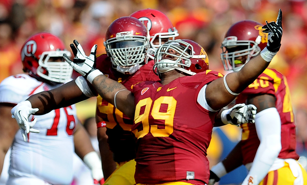 . Southern California defensive tackle Antwaun Woods (99) reacts after sacking Utah quarterback Travis Wilson ( not pictured) during the first half of an NCAA college football game in the Los Angeles Memorial Coliseum in Los Angeles, on Saturday, Oct. 26, 2013.  (Photo by Keith Birmingham/Pasadena Star-News)