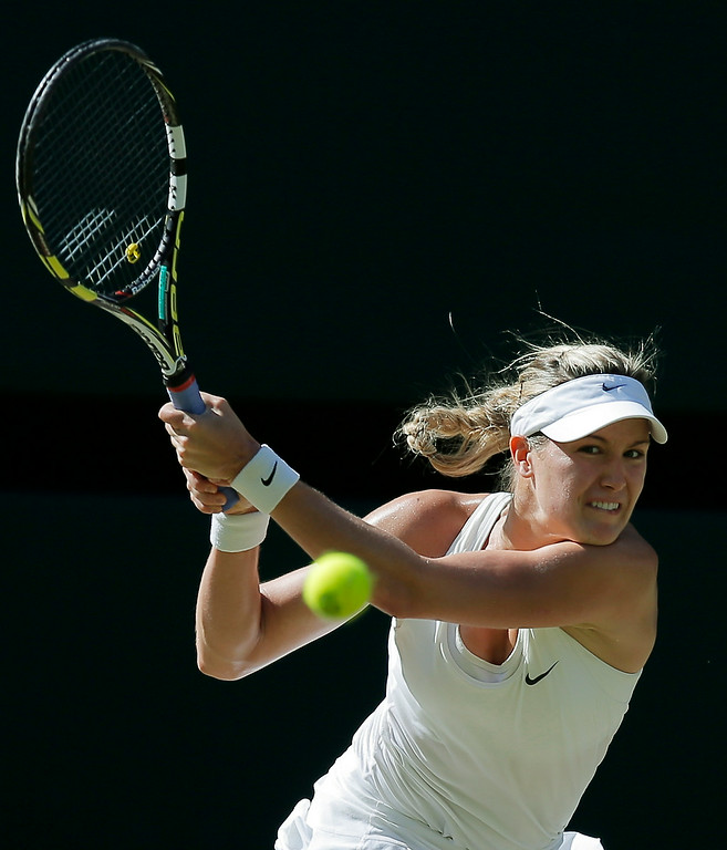. Eugenie Bouchard of Canada plays a return to Simona Halep of Romania during their women\'s singles semifinal match at the All England Lawn Tennis Championships in Wimbledon, London, Thursday, July 3, 2014. (AP Photo/Pavel Golovkin)