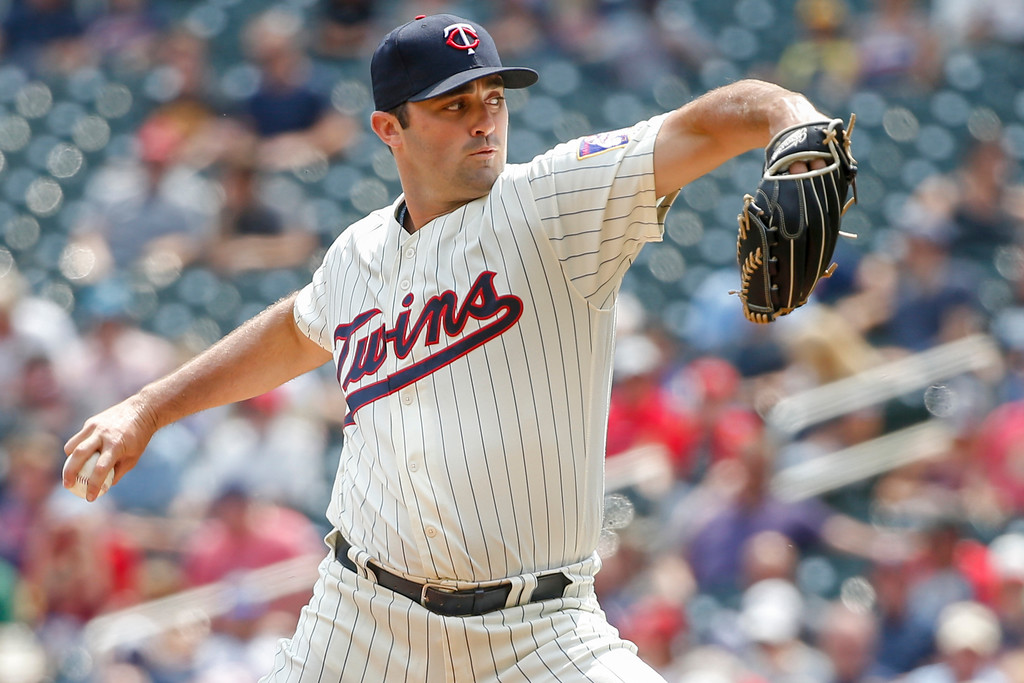 . Minnesota Twins relief pitcher Matt Magill throws to the Cleveland Indians in the sixth inning of a baseball game Wednesday, Aug. 1, 2018, in Minneapolis. (AP Photo/Bruce Kluckhohn)