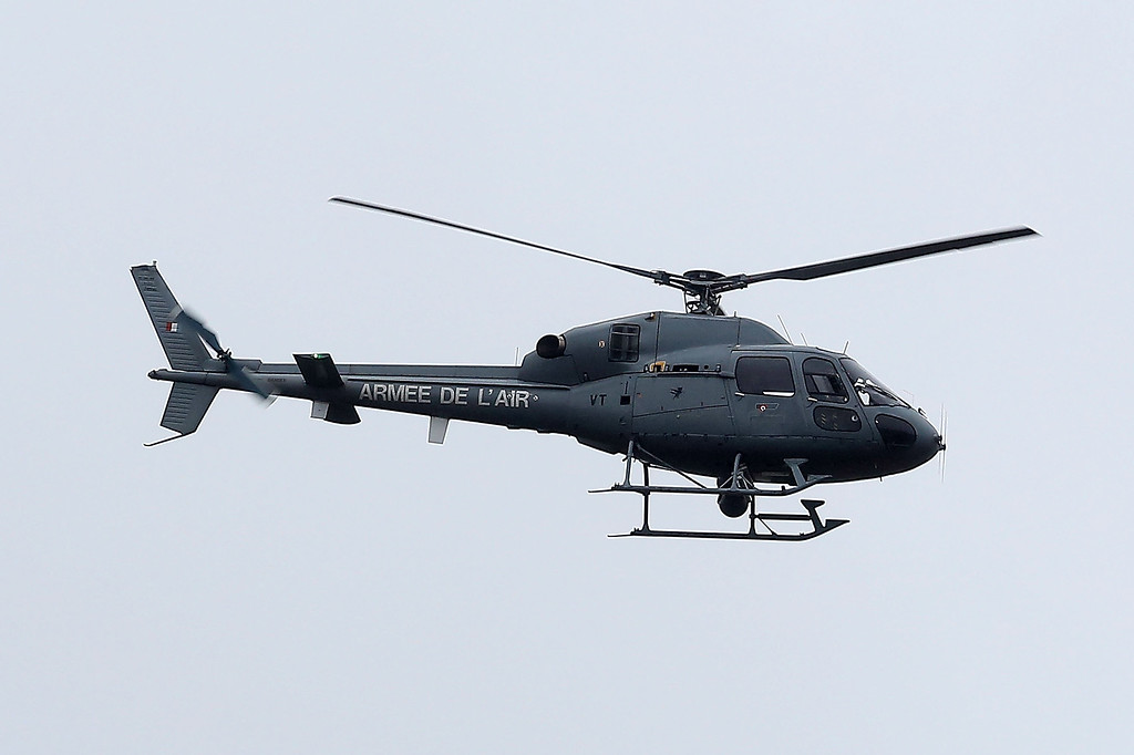 . A helicopter of the french Special Police Forces looks for the suspects linked to the \'Charlie Hebdo\' attack near Dammartin-en-Goelle on January 9, 2015 in Paris, France. A huge manhunt for the two suspected gunmen in wednesday\'s deadly attack on french satirical newspaper \'Charlie Hebdo\' has entered its third day  (Photo by Marc Piasecki/Getty Images)