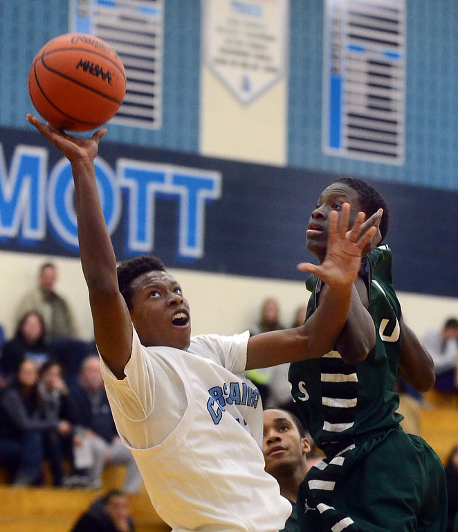 . Waterford Mott\'s #11 Austin Sherrell puts up a shot while drawing the foul from West Bloomfield\'s #3 Mitchell Bailey during their game at Waterford Mott High School, Thursday December 12, 2013. West Bloomfield went on to win the game 55-52. (Vaughn Gurganian-The Oakland Press)