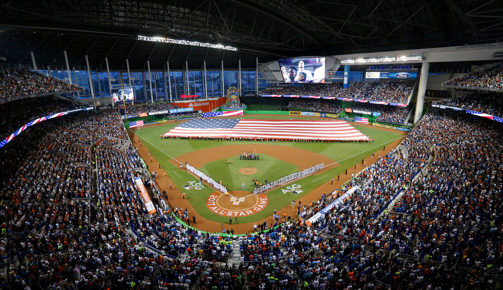 . The National Anthem is played during the MLB baseball All-Star Game, Tuesday, July 11, 2017, in Miami. (AP Photo/Wilfredo Lee)