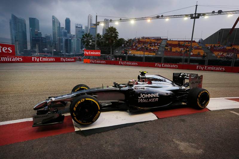 . McLaren driver Kevin Magnussen of Denmark steers his car during the first practice session for the Singapore Formula One Grand Prix on the Marina Bay City Circuit in Singapore, Friday, Sept. 19, 2014. In the background, the Singapore financial skyline is seen. (AP Photo/Ng Han Guan)