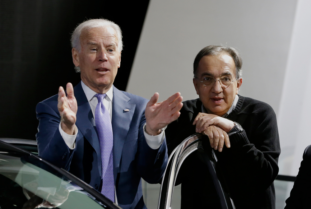 . Vice President Joe Biden and Chrysler-Fiat CEO Sergio Marchionne tour the North American International Auto in Detroit, Thursday, Jan. 16, 2014. Biden said the U.S. auto industry\'s resurgence since the 2009 federal bailout provides a strong basis for a Motor City recovery.  (AP Photo/Carlos Osorio)
