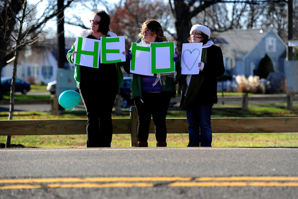 Description of . Community members hold a sign for the procession during the funeral service for Victoria Soto, 27, in Stratford, Connecticut on Wednesday, December 19, 2012. Soto, a first grade teacher, was shot and killed during the Newton shooting as she attempted to protect her students against the gunman. AAron Ontiveroz, The Denver Post