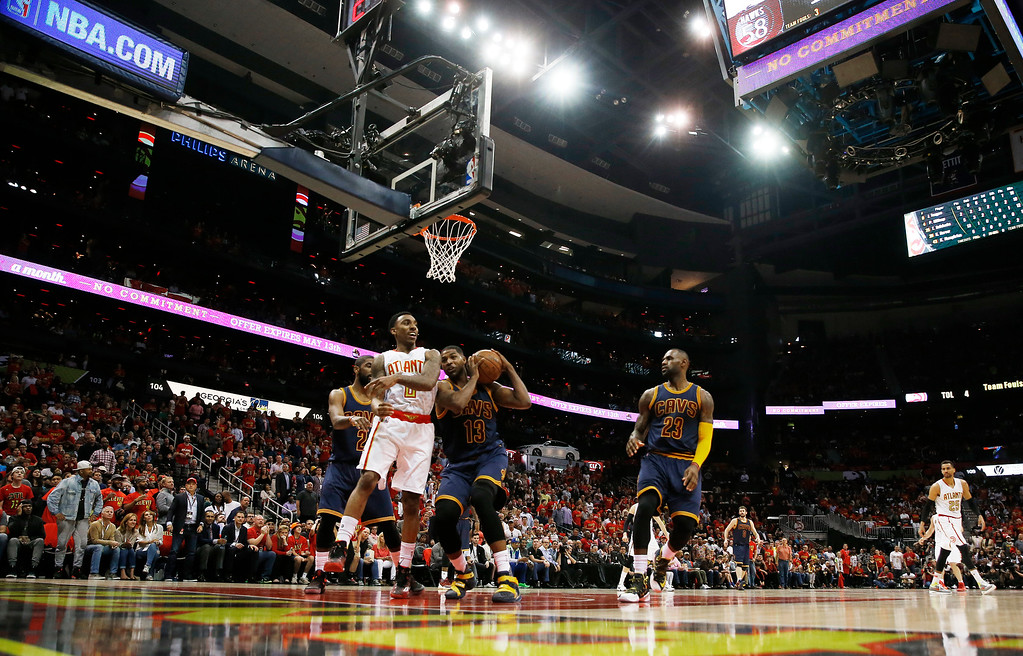 . Cleveland Cavaliers center Tristan Thompson (13) works against Atlanta Hawks guard Jeff Teague (0) in the first half of Game 3 of the second-round NBA basketball playoff series, Friday, May 6, 2016, in Atlanta. (AP Photo/John Bazemore)