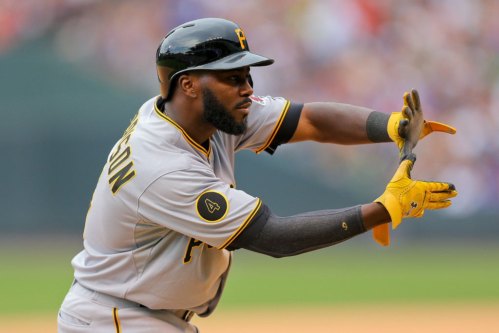 . Josh Harrison #5 of the Pittsburgh Pirates celebrates towards the dugout after stealing second base and advancing to third base in a run-down during the sixth inning against the Colorado Rockies at Coors Field on July 27, 2014 in Denver, Colorado. The Pirates defeated the Rockies 7-5. (Photo by Justin Edmonds/Getty Images)