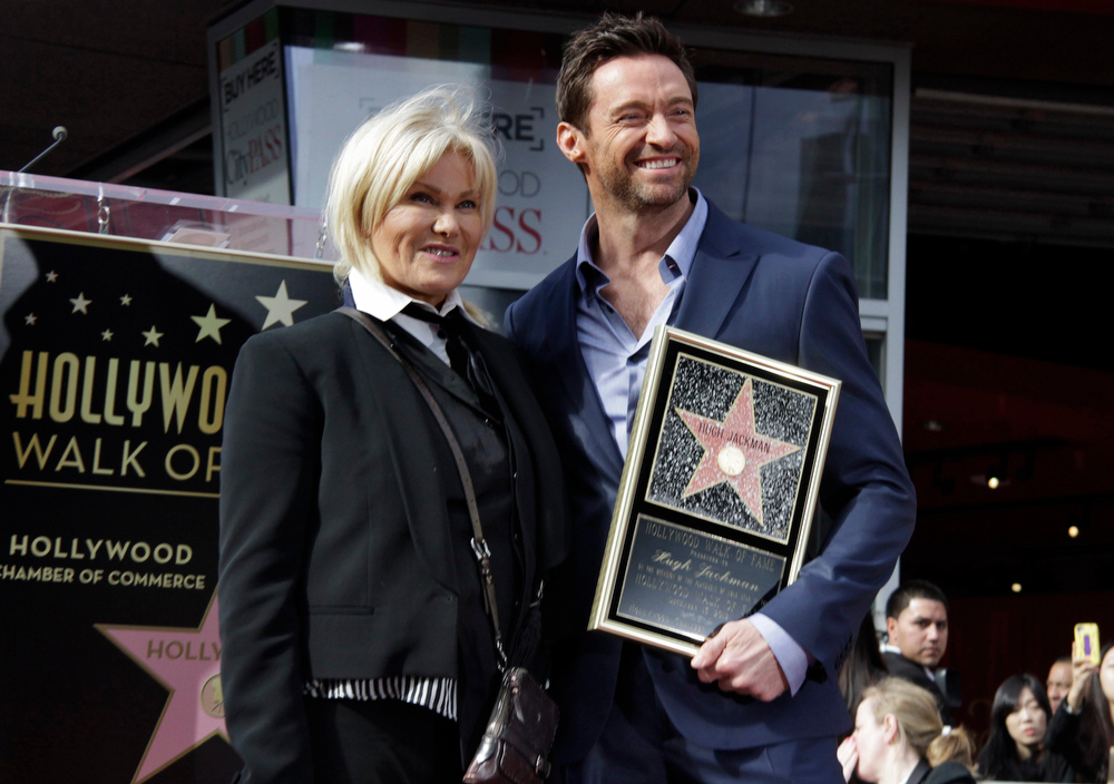 Description of . Actor Hugh Jackman (R) and his wife Deborra-Lee Furness pose together during ceremonies honoring Jackman with a star on the Hollywood Walk of Fame in Hollywood, California, December 13, 2012. REUTERS/Jonathan Alcorn
