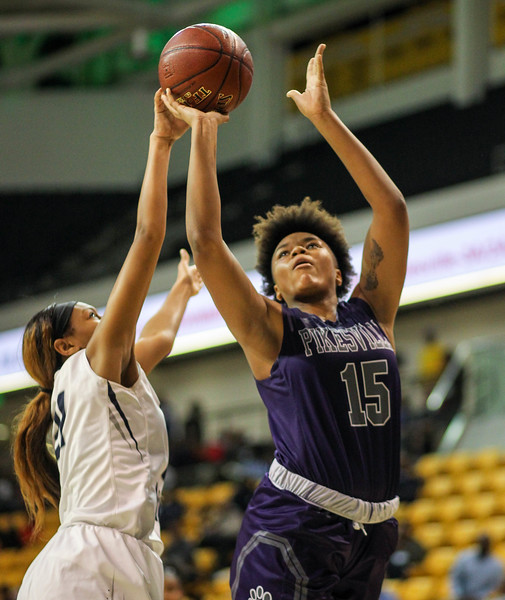 March 15, 2019: Pikesville forward Kristin Sterling (15) shoots a shot past Largo forward Taylor Lewis (21) during MPSSAA girls basketball 1A Semifinal matchup between Pikesville HS and Largo HS in Towson. Photo by: Chris Thompkins/Prince Georges Sentinel